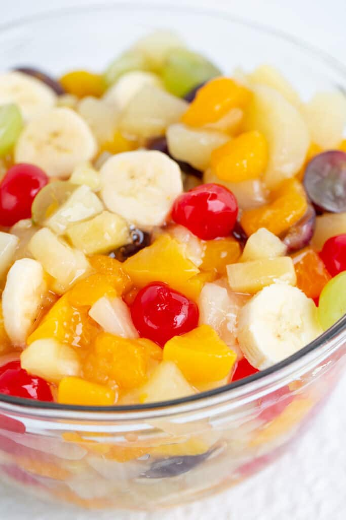 close up of a glass bowl full of fruit salad