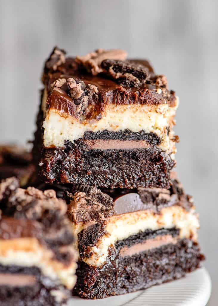 stacked brownie bars with a gray background