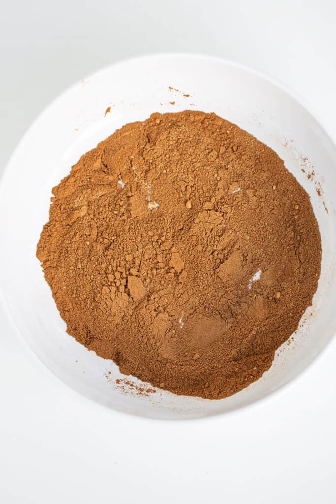 spices mixed together in a large bowl on a white surface