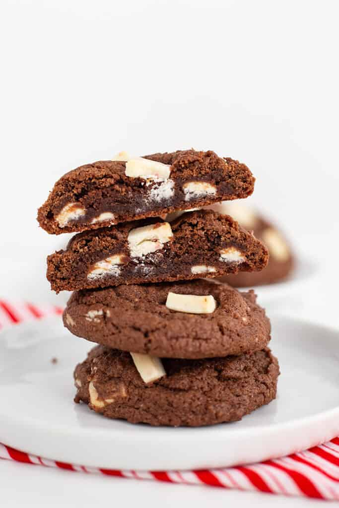stack of cookies with the top one sliced in half showing the inside