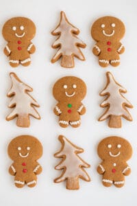 gingerbread cookies layed out on a white surface