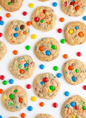 overhead photo of m&m cookies with M&M candies around the cookies