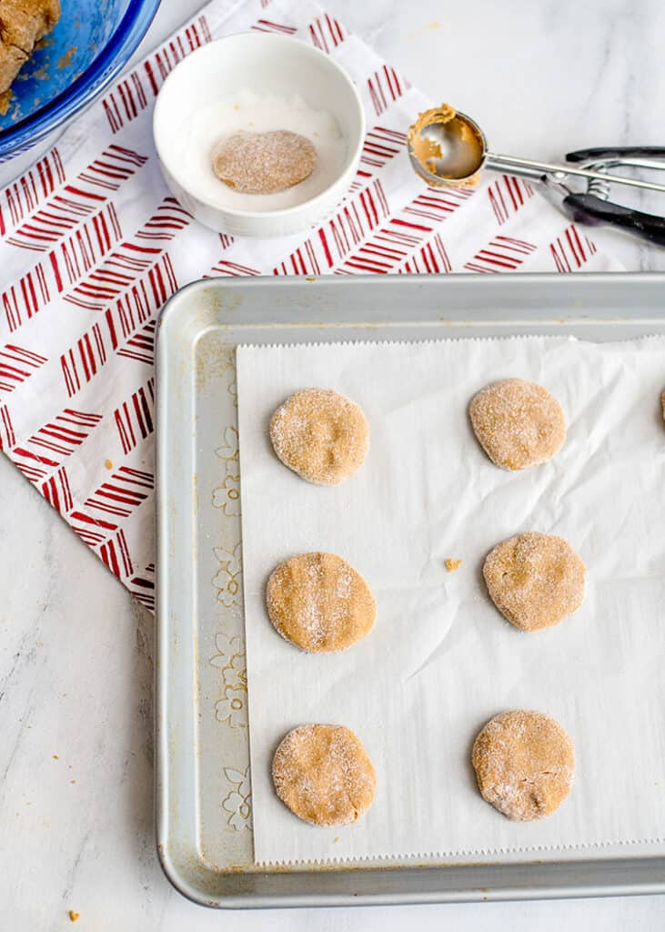 baking pan full of cookies with a linen beneath it