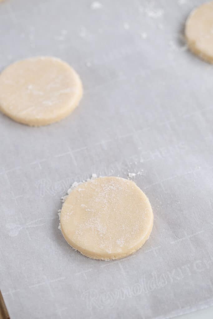 cut out sugar cookies on a parchment lined baking sheet