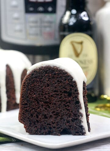 slice of bundt cake on a white square plate with a beer behind it and instant pot