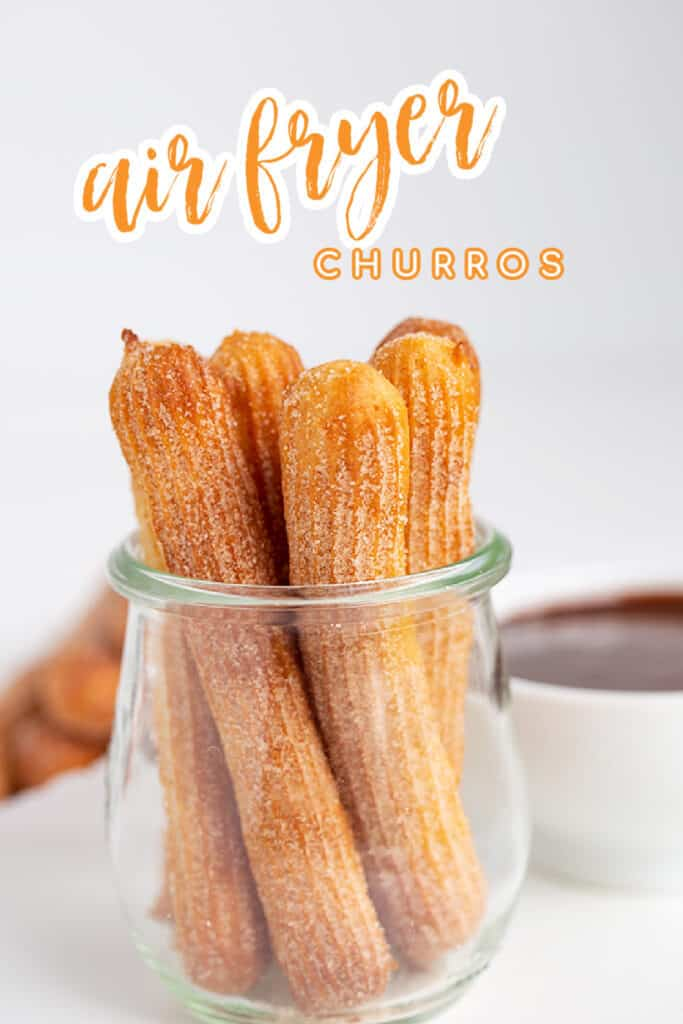 close up of churros in a glass jar with text at the top for the recipe name