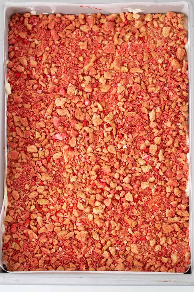 overhead photo of the strawberry crunch dessert in a 9x13 pan