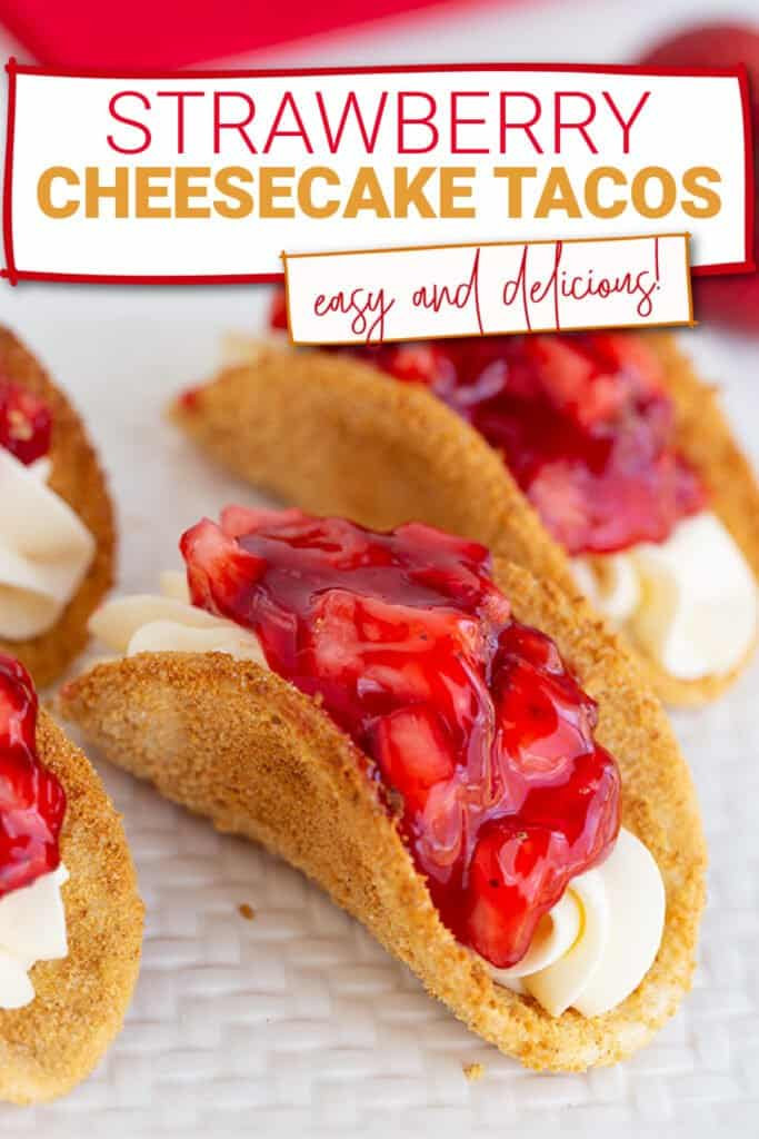 close up of a strawberry cheesecake tacos on a white textured cutting board with the recipe name in a box at the top