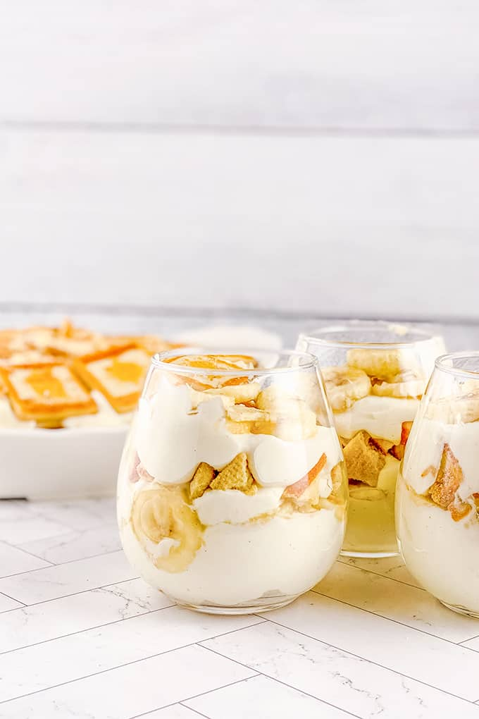 glasses of dessert on a white surface
