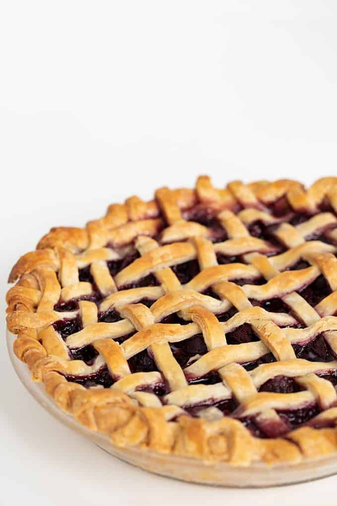 a whole pie on a white surface
