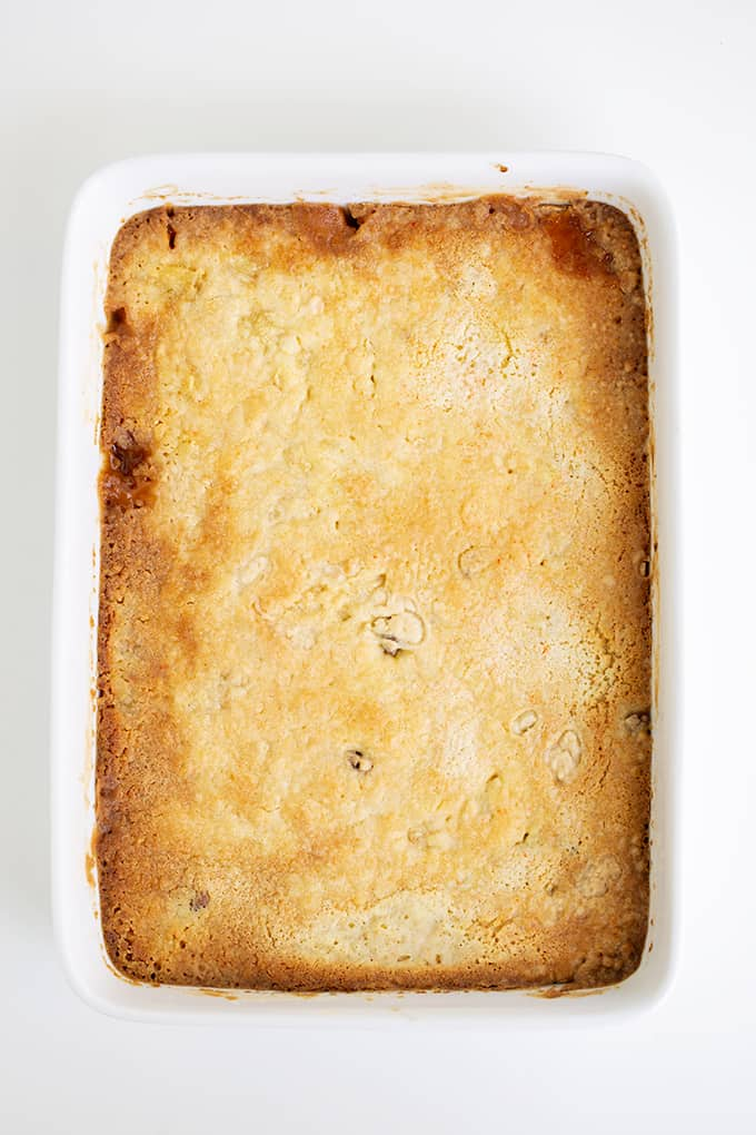 overhead photo of the dump cake in the pan over it's been baked on a white surface