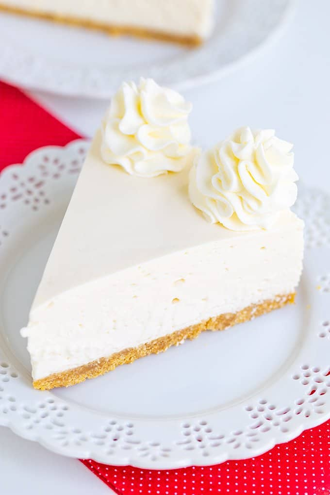 no bake cheesecake on a white plate with a red fabric under the plate