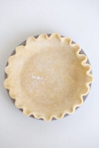 overhead view of a unbaked pie crust in a pan