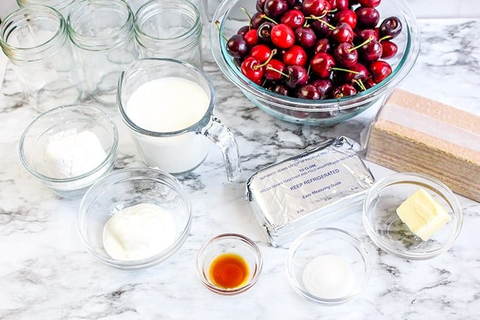 Ingredients on a marble background for no bake cheesecakes in a jar